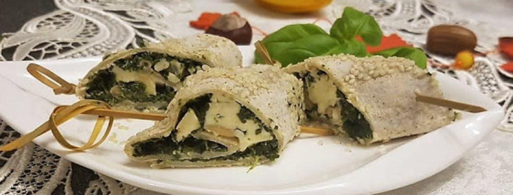 Vegetarische Taquilinos mit Fourme d'Ambert, Spinat und Pinienkernen